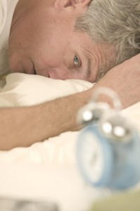 Man Waking to Alarm Clock